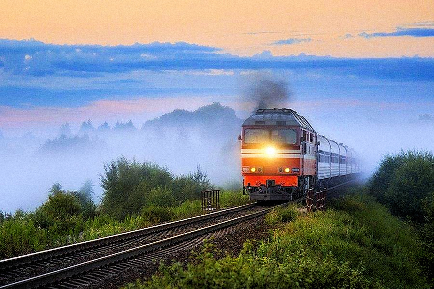 00 Ilya Semyonov. Diesel Locomotive TEP70 Driving Ivanovo-St Petersburg Passenger Train at Udomlya Station in Tver Oblast. 2016
